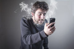 Man angry at phone Stock Photography