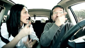 Man angry in traffic driving woman trying to calm stock video
