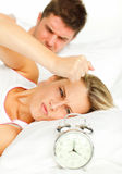 Man and angry woman in bed Royalty Free Stock Image