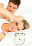 Man and angry woman in bed Royalty Free Stock Photos