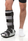 Man with an ankke brace royalty free stock image
