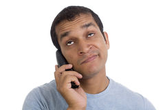 Man Annoyed and bored at Phone on Hold again Royalty Free Stock Image