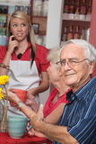 Man Annoyed with Waitress Royalty Free Stock Image