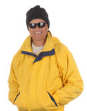 Man in anorak and watch cap. Smiling man in yellow anorak, watch cap and sunglasses isolated over white. Torso only in vertical format Stock Photos