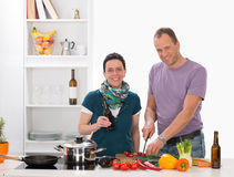 Man ans woman in the kitchen Stock Photos