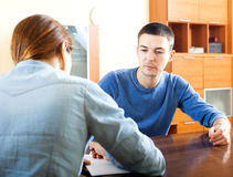 Man  answer questions. Of outreach worker with paper in office Stock Images