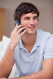 Man answering phonecall. Smiling young man answering phonecall Stock Image
