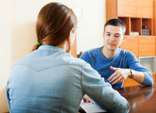 A man answering questions. Guy answer questions of outreach worker with paper in home or office Stock Images
