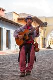 Man in Antigua Guatemala playing the guitar. February 8, 2015 Antigua, Guatemala: man in traditional clothing playing guitar on the street Stock Images