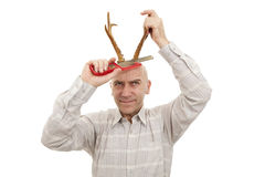Man with antlers. On head saws horns stock photo