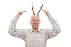 Man with antlers. Crying man with antlers on head on white royalty free stock photography