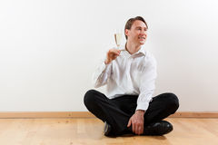 Man in apartment with champagne Royalty Free Stock Image