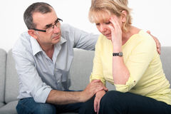 Man apologizing. After an argument with his wife in the living-room Royalty Free Stock Images
