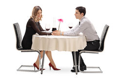 Man apologizing to his girlfriend. Young men apologizing to his girlfriend seated on a date isolated on white background Royalty Free Stock Photos