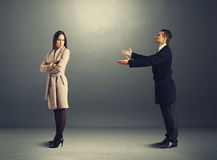 Man apologizing to offended woman. Young men apologizing to offended woman Stock Images