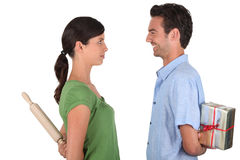 Man apologizing to woman. Man apologizing to women with rolling-ping Royalty Free Stock Images
