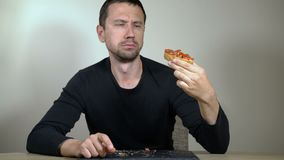 The man with an appetite eats bruschetta. At home stock video