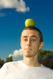 Man with apple. At head Royalty Free Stock Photos