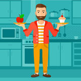 Man with apple and cake. Royalty Free Stock Image