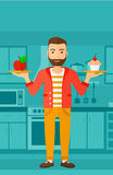 Man with apple and cake. Royalty Free Stock Photography