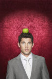 Man With Apple On His Head Stock Photos