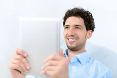 Man with apple ipad Royalty Free Stock Photos