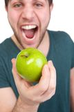 Man with apple and mouth open Royalty Free Stock Image