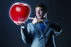 Man with apple Stock Photography