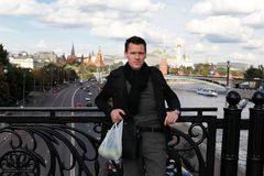 Man with apples on bridge. Moscow Stock Photography