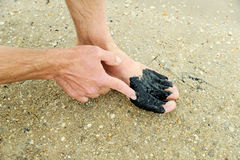 Man applies  therapeutic mud. Stock Photos