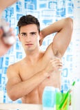 Man applying antiperspirant Royalty Free Stock Photography