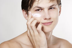 Man applying cream Stock Photography