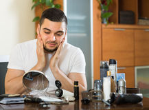 Man applying cream on face skin Royalty Free Stock Image