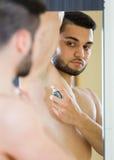 Man applying deodorant Stock Images