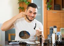Man applying facial cream at home Royalty Free Stock Photos