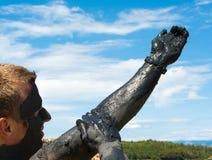Man applying healing clay Royalty Free Stock Photo