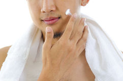 Man applying lotion Royalty Free Stock Image