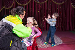 Man Applying Make Up to Face of Girl on Stage Royalty Free Stock Photos