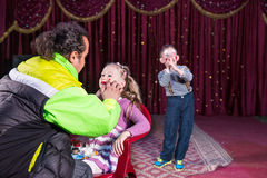 Man Applying Make Up to Face of Girl on Stage Stock Images