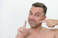 Man applying moisturizer to his skin Stock Image