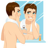 Man Applying After Shave Royalty Free Stock Photos