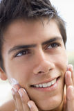 Man applying shaving cream Stock Photography