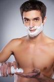 Man applying shaving cream. royalty free stock images