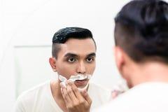 Man applying shaving foam Royalty Free Stock Images