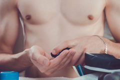 Man applying shaving foam on his hand Royalty Free Stock Photo