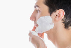Man applying shaving foam Royalty Free Stock Photos