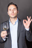 Man approving a glass of white wine Royalty Free Stock Photo