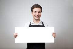 Man with apron and board Royalty Free Stock Photos