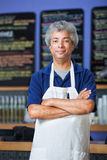 Man in Apron with Folded Arms Stock Photo