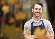Man with apron in forest with leaves. Digital composite of Man with apron in forest with leaves Stock Photography